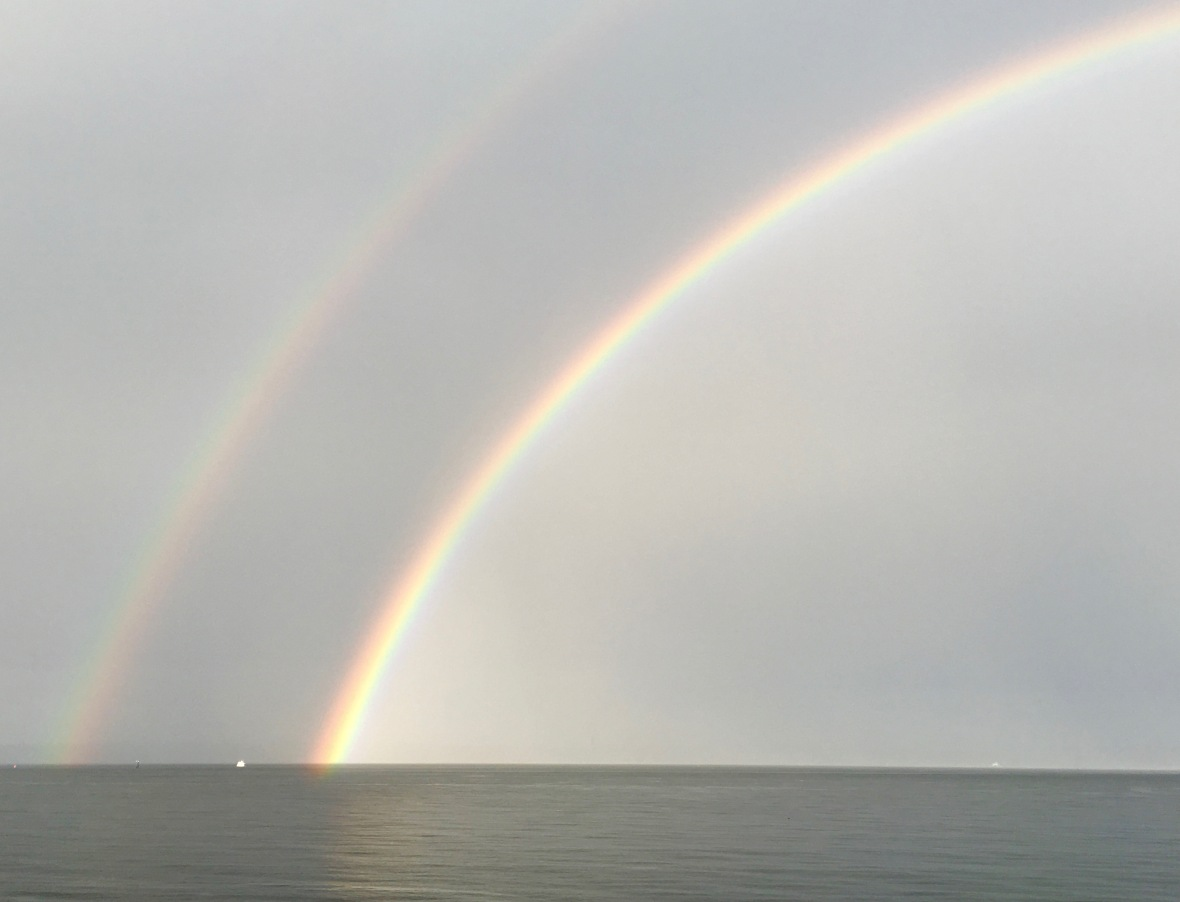 double rainbow touching water